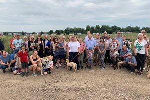 Biggleswade residents, including families and dog walkers, gathered with Cllr Dr Hayley Whitaker on the proposed site to discuss the housing application