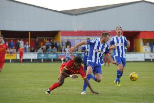 Banbury United's Denilson Silva loses out to Nuneaton Borough's Declan Towers during Tuesday's game