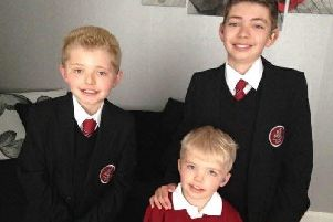 Dean with his brothers Rhys and Carter.