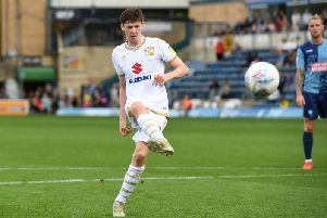Conor McGrandles sent his penalty over the bar at Wycombe