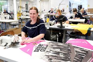 Zoe Carlin at work on the new 'Derry Girls' line of products.