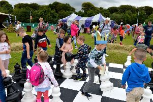 Children have fun with the large chess set at a previous Carnival of Colours in St Columb's Park.  DER3518GS048