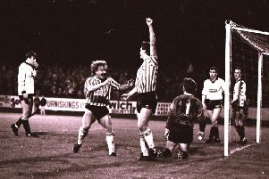 Derry City's Johnny Speak celebrates with Noel Larkin after the striker put the Candy Stripes 2-0 up in the 1988 League Cup final against Dundalk at Oriel Park.