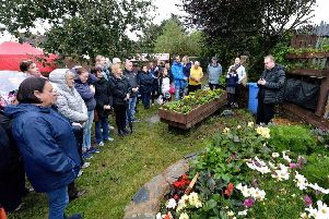 Fr Joe Gormley PP, St Mary's Church, Creggan leads a Service of Remembrance, in the garden of the Creggan Community Collective on Tuesday evening last, marking World Suicide Prevention Day 2019 and remembering those who have died by suicide locally. DER3719GS ' 021