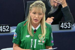 Martina Anderson pictured wearing a jersey once worn by Derry man and Republic of Ireland international James McClean.