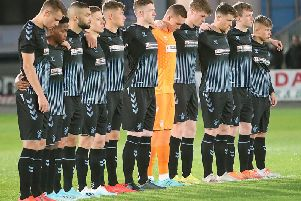 The Rangers players observe a minute's silence in memory of Fernando Ricksen