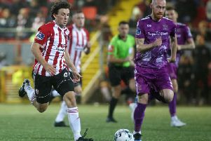 Derry City's Barry McNamee races away from Dundalk's Chris Shields.