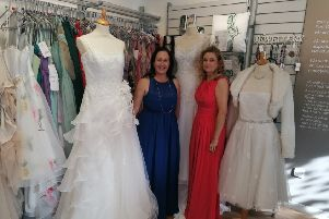 Paula Sweeney and Wendy Cunningham model some of the dresses.