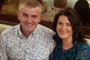 Adoptive parents, Derry couple Eoin and Denise.