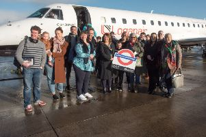Mayor Michaela Boyle pictured with passengers ahead of the first flight.