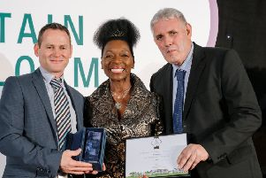 John Quinn (left), Derry City and Strabane District Council Streetscape Manager, pictured with Floella Benjamin and William Ferguson, Grounds Maintenance Supervisor, receiving the Britain in Bloom Small City award. (RHS / Richard Dawson)