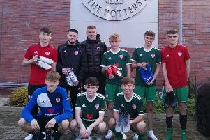 Republic of Ireland winger James McClean pictured presenting football boots to Derry City U15 squad.