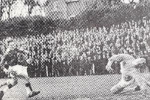 1964... Action from the Kennedy Cup Final between Carfin Emeralds and Manchester Athletic at Movilles Bay Field.