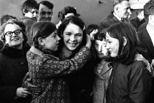 Dana is greeted by relatives and well wishers after arriving into Ballykelly on the special Aer Lingus flight from Amsterdam following her historic Eurovision win with 'All Kinds of Everything' in March 1970.