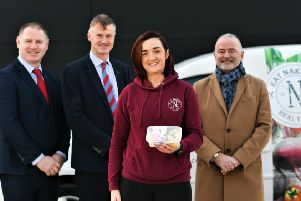 William McCulla, Invest Northern Ireland's Director of Corporate Finance (centre); Harry McDaid, CEO, UCIT (right) and Donal Leahy, Senior Lending Executive, Enterprise Northern Ireland (left) with Caoimhe O'Kane, Founder of Eat Naked NI.