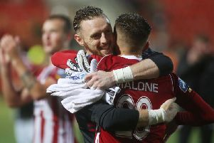 Peter Cherrie celebrates with Jack Malone last season.