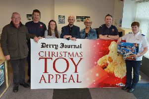 Launching the 20th annual Derry Journal Christmas Toy Appeal are from left to right: Bill Etherson, St. Vincent DePaul, Richard Ayton, NI Fire & Rescue Service Northland Road (Red Watch), Aideen McGrory, Brendan McDaid and Jacqui Diamond, Derry Journal, Patrick Kennedy, NI Fire & Rescue Service Northland Road (Red Watch) and Doreen Chapman from the Salvation Army. (Picture by George Sweeney)