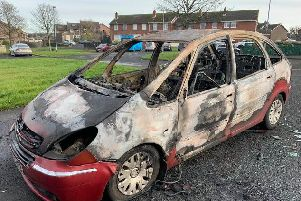 The torched vehicle in Galliagh Park.