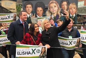 John Finucane, Elisha McCallion and Michelle O'Neill pose for a selfie.