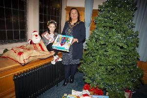 """ALICIA'S TOY APPEAL. . . . . .The Mayor of Derry City and Strabane District Council, Michaela Boyle presenting six years old Alicia Scully with some presents towards her Christmas Toy Appeal for Wards 6 and 16, Altnagelvin Hospital. Alicia was inspired by the delivery and donation of toys to the hospital last year when she was a patient and decided to start her own campaign to collect toys in the run up to Christmas. It�""""s understood she has a number of drop-off points across the city for donations. (Photo: Jim McCafferty Photography)"""