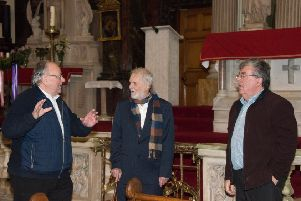 Local amateur historian Ivor Doherty takes Charles Hett on a tour of the Long Tower Church. Also pictured is Giovanni Doran, Chair of Aras Cholmcille Trust.