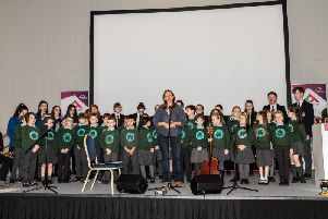 Pupils from Oakgrove Primary School, Lumen Christi and St Mary's College at the event in Foyle Arena to celebrated the installation of the Peace Tree
