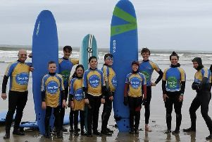Some of the young people from Circle of Support on a surfing trip.