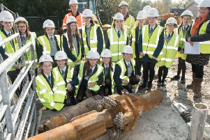 Pupils from Thornhill College and their teacher Sheena Scott pictured last year with  Firmus Energy Construction Manager, Jonathan Strain,and Declan Carlin, Project Manager, Kier, when they visited Firmus Energy's  Foyle Crossing where a gas pipeline emerges from under the River Foyle . The pupils inspected the drill bit which was used during the project. Picture Martin McKeown. Inpresspics.com.