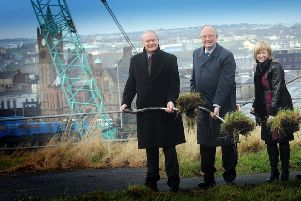 The Deputy First Minister, Martin McGuinness, MLA, Sir Roy McNulty, chairman, Ilex, and Aideen McGinley, Chief Executive, cutting the first sod on the Peace Bridge at Ebrington in 2010.