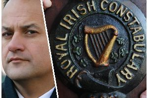 Taoiseach Leo Varadkar and the coat of arms belonging to the RIC.