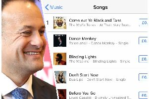 Taoiseach Leo Varadkar and a screenshot [taken Thursday afternoon] showing 'Come Out Ye Black & Tans' top of the iTunes charts.