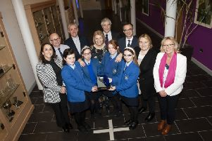 """ST. MARY�""""S AWARD. . . .Mrs. Gay Durkan, Chair, Board of Governors, St. Mary�""""s College and some of the school�""""s pupils pictured with the prestigious ��Efffective Schools Governance�"""" award, presented to the school this week. St. Mary�""""s is the only school in Northern Ireland to receive this award from Optimus Education which is judged on nine elements that address the Ofsted criteria for effectiveness of leadership and management. Included back from left are Yvonne Connolly, Senior Teacher, Gavin Molloy, Fr. Paul Farren and Padraig Canavan, Board of Governors, Brendan McGinn, Vice Principal, Delma Boggs and Finola Downey. (Photo: Jim McCafferty Photography)"""