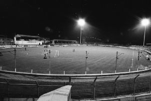 A view of the Brandywell Stadium as the floodlights come on for the first time ahead of the friendly against Leicester City in January 1990.