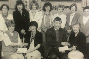 Seapatrick Parish young wives group had over cheques to Crossroads Care co-ordinator Mary Hutchinson and Rev John Scott.