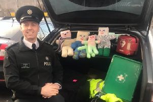 Chief Inspector Jon Burrows with the Trauma Teddies.