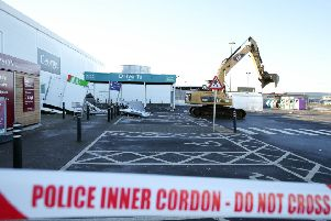 A digger was used to rip two ATMs from the wall of a building at the Asda supermarket in Antrim in the early hours of Friday, February 1. ''Photo by Matt Mackey, Press Eye