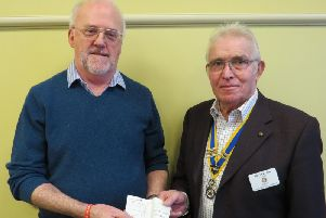 President David Brain presented him with a cheque towards the work of APS Support UK. Photo submitted