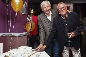 Alan Goss (L) and Phil Baker (R) cut the 50th anniversary cake