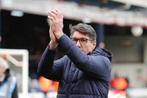 Hatters boss Mick Harford applauds the Luton supporters