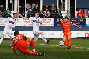 James Collins goes for goal against Rochdale