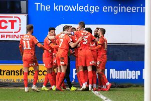 Luton celebrate opening the scoring against Rochdale last weekend
