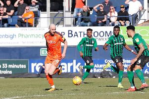 Danny Hylton picked up a harsh booking at Plymouth yesterday