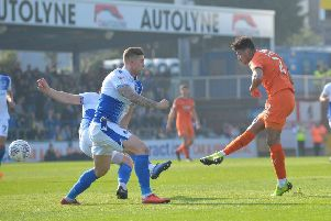 James Justin shoots for goal against Bristol Rovers