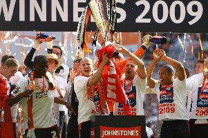 Luton celebrate lifting the Johnstone's Paint Trophy after beating Scunthorpe United