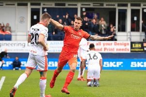 James Collins wheels away after opening the scoring for Luton this afternoon