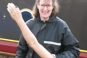 A member of the clean-up crew with the arm found in the canal