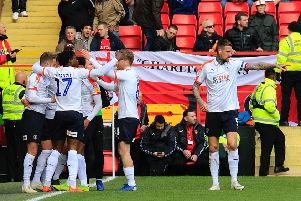 Harry Cornick is mobbed after opening the scoring at Charlton