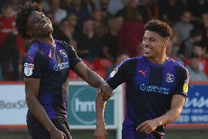 Pelly-Ruddock Mpanzu celebrates making it 3-0 against Accrington