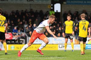 James Collins puts the Hatters 1-0 up at Burton Albion