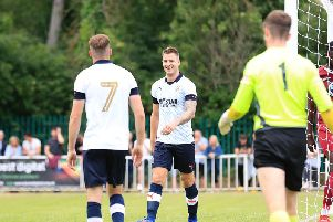 James Collins smiles after making it 2-0 to Town on Saturday